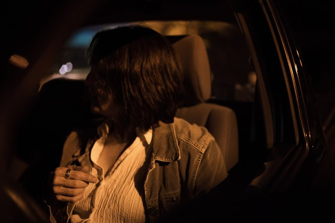 Sandy Sitting In Her Car