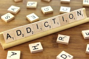 Addiction Spelled Out in Scrabble Pieces
