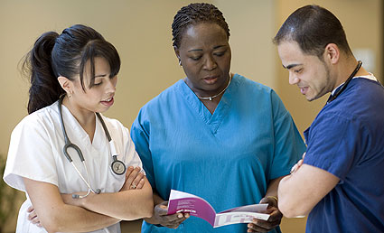 Nurses discussing pamphlet