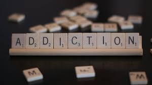 Scrabble-pieces-spell-ADDICTION